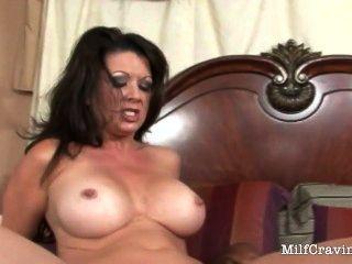 Busty Milf Sits On A Big Black Cock