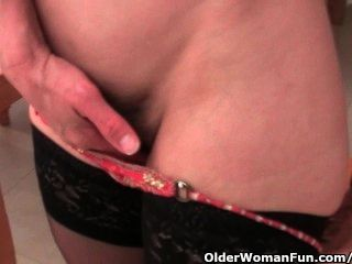 Granny In Stockings Works Her Hairy Pussy With A Dildo