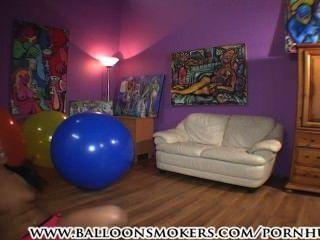 Teen Jumps And Falls On Big Balloons
