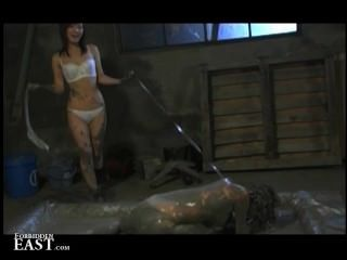 Femdom Puts Her Japanese Female Sex Slave Into A Mud Bath And Torments Her