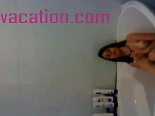 Brunette Bathes And Shows Tits For The Camera