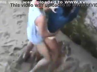 Couple Caught Fucking On Beach