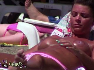 Big Fake Boobs On The Sunbed Tindering And Rubbing Oil In Massive Tits
