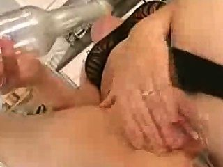 Brunette Fucks Hers Pussy With A Bottle In Kitchen