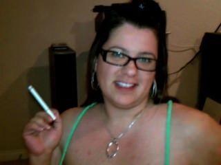 image Holder smoking tranny seduces young boy