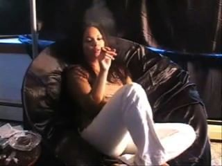 Girl Smoking Cigar At Sofa