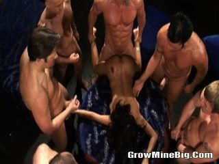 Horny Brunette Sorrounded By Many Bigcocks