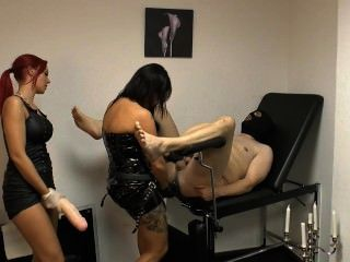 Lady Xenia And Friend Punish Slave With A Huge Strap-on