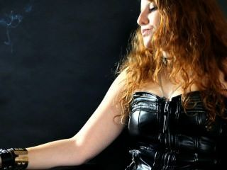 Smoking Redhead Julietta In Leather Leggings And Corset