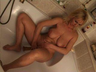 Mature Blonde Rides Dildo In Bathtub