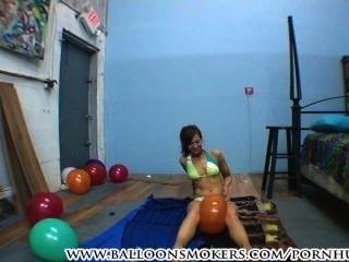 Teen In Bikini Pops Balloons